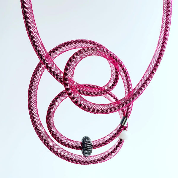 This Tubular is made with black/white shock cord and berry red netted tubing. it is 115cm