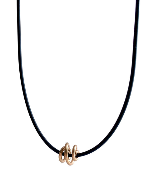 This Rubber Loopt necklace is in round copper. Made of aluminum wire and hangs on a rubber necklace with an interlocking closure. This piece comes in many variations.