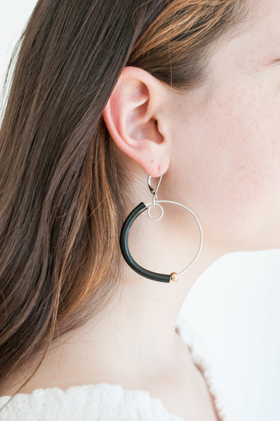 Sadye is wearing Hoopt earrings in flat silver with black and gold. This picture gives you an idea of the size of the hoops even though they are not the same exact earring.