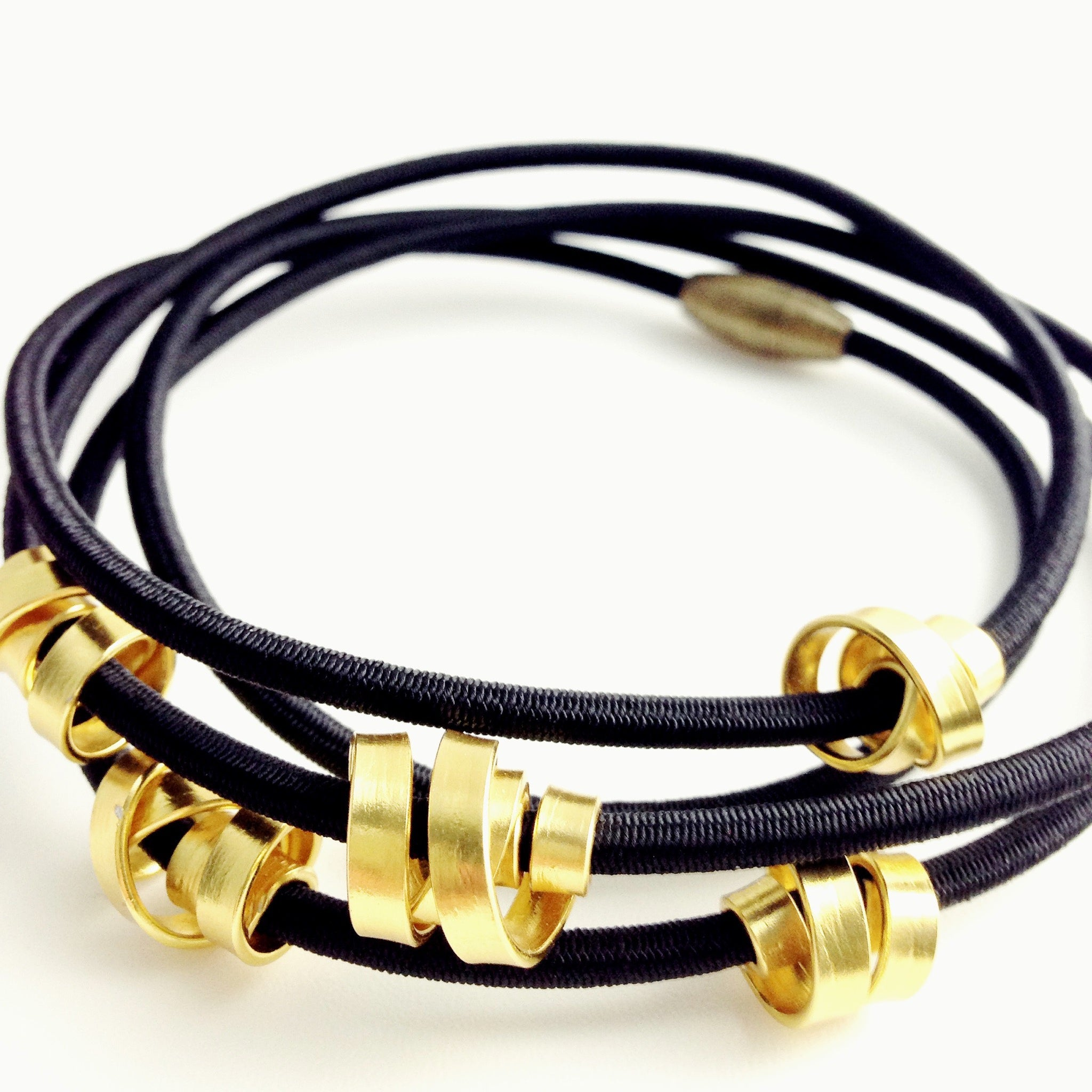 A 112cm Loopt necklace/bracelet in fine black and flat gold coloured aluminum wire.