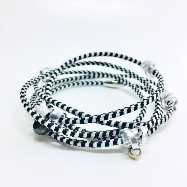 This is a 112cm Loopt in fine black and white cord with a mix of flat and thin silver aluminum wire.