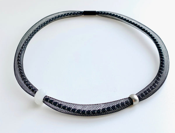 This Short Tubular is made with black/white shock cord and black netted tubing. it is 44cm