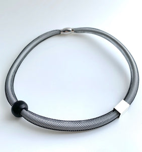 This Short Tubular is made with white shock cord and black netted tubing. it is 43cm