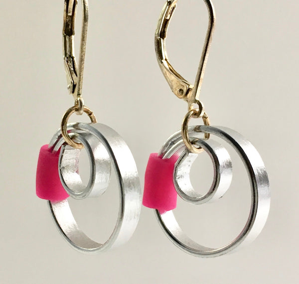These Reel with a pink accent hang about 2cm.