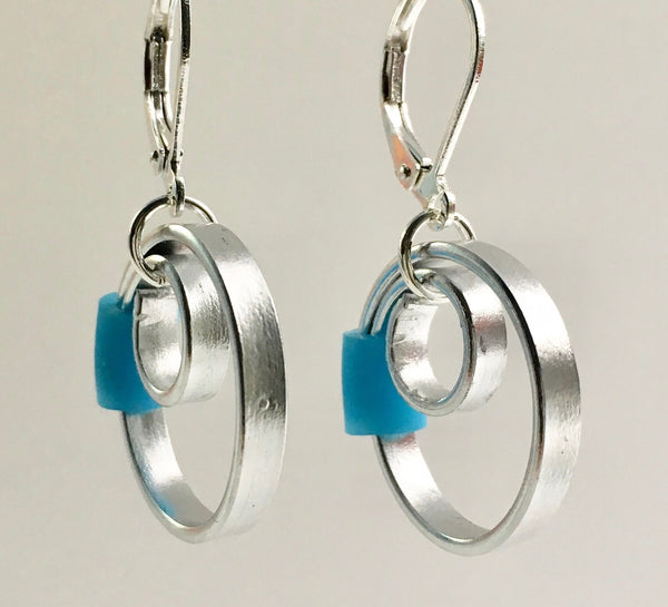 These Reel with a turquoise accent hang about 2cm.