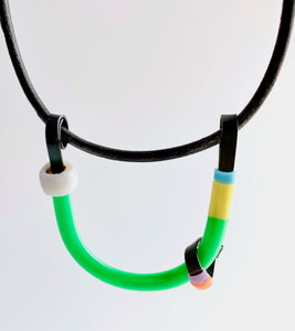 This Uline necklace hangs on a leather cord with a magnetic clasp that is 40cm in length.