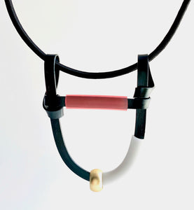This Uline necklace hangs on a shock cord with a magnetic clasp that is 43cm in length.