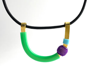 This Uline necklace hangs on a fine black shock cord with a magnetic clasp that is 46cm in length.
