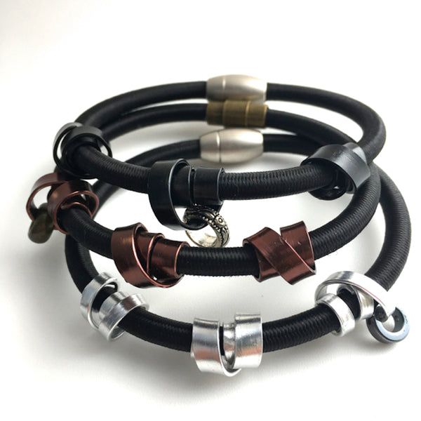 Three Loopt bracelets in heavy cord with flat wire.