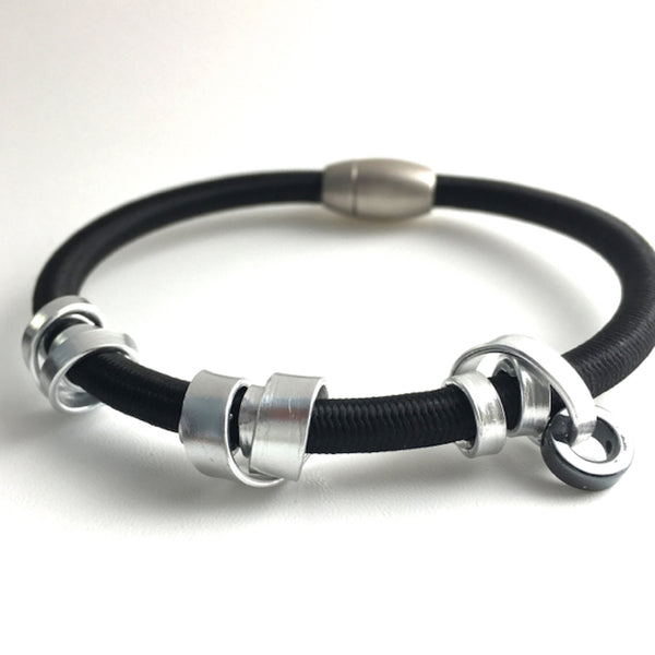 This is a Loopt bracelet on heavy cord and silver coloured aluminum wire.