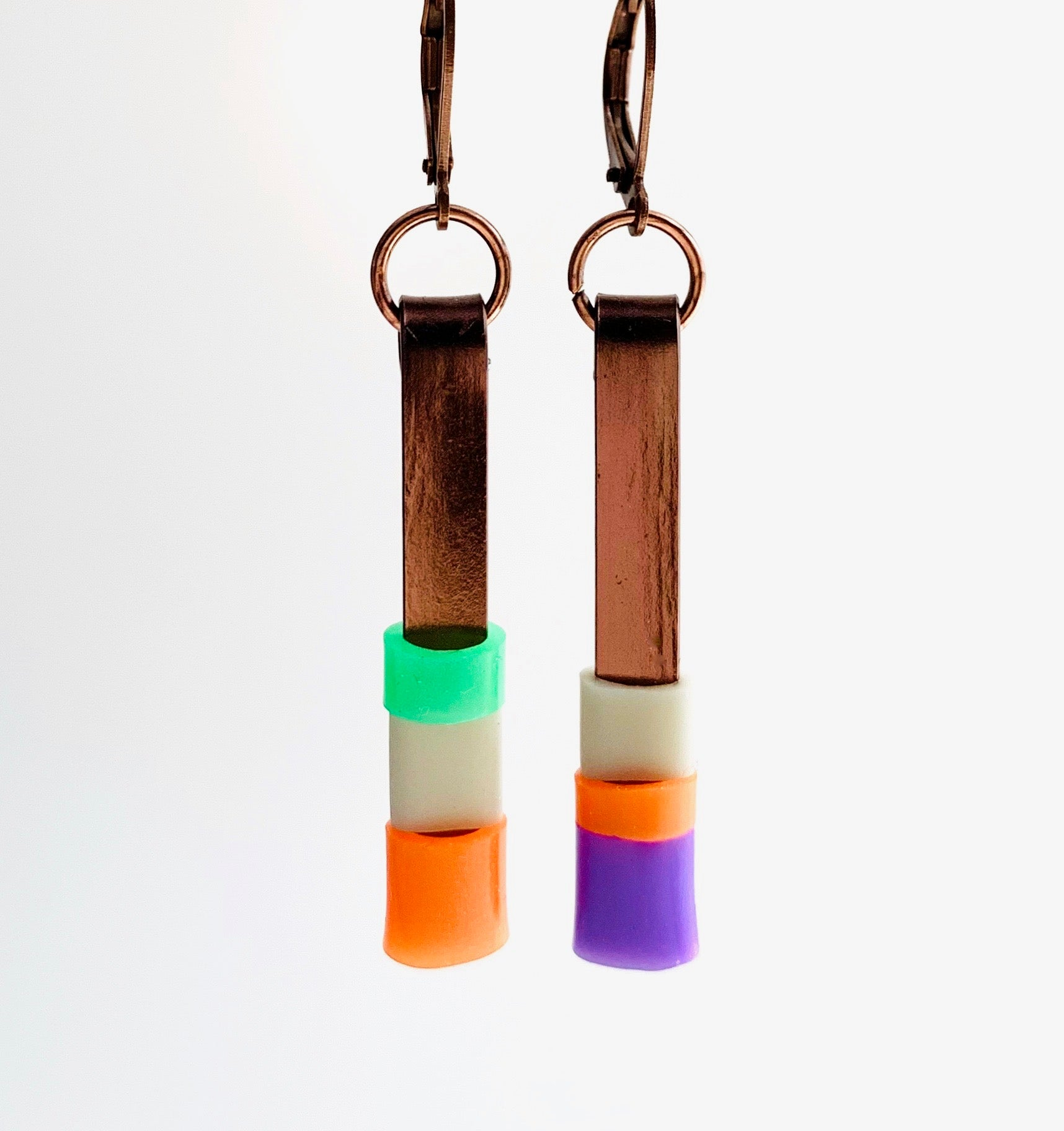 Matchstick earrings in bronze coloured aluminum wire with orange, purple, beige and green coloured silicone tubing. These hang 4cm in length.