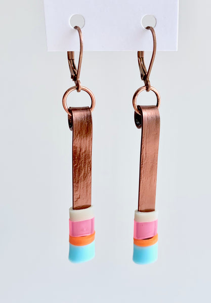 Matchstick earrings in bronze coloured aluminum wire with light blue, pink, beige and orange coloured silicone tubing. These hang 4.5cm in length.