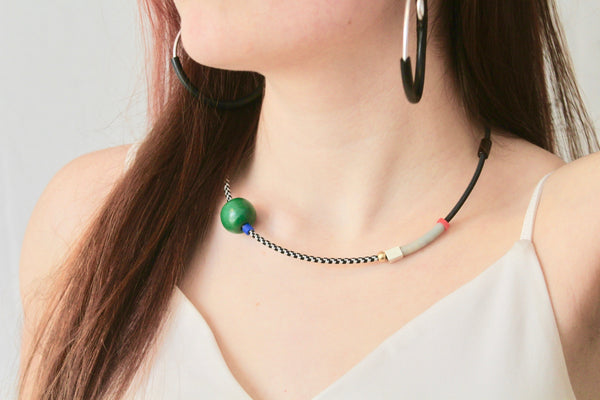Sadye wears CCC in black and white with big green wooden bead + Hoopt earrings in silver + black