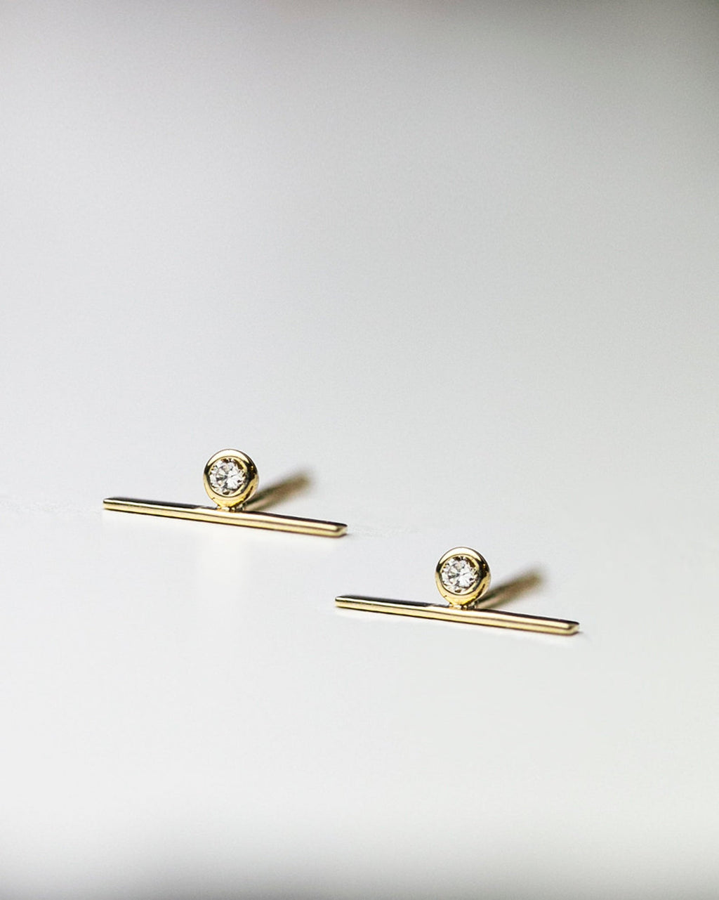 14k Lind bar studs with diamond accent