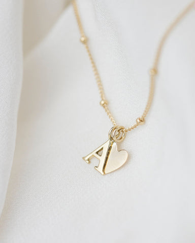 14k gold letter necklace with small diamond