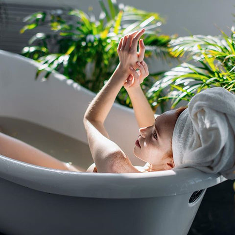 a woman bathing in tub relaxing