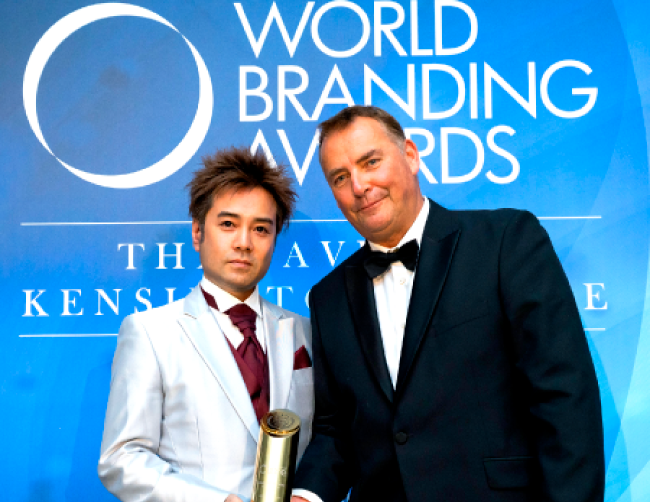 Cure accepting the World Branding Award