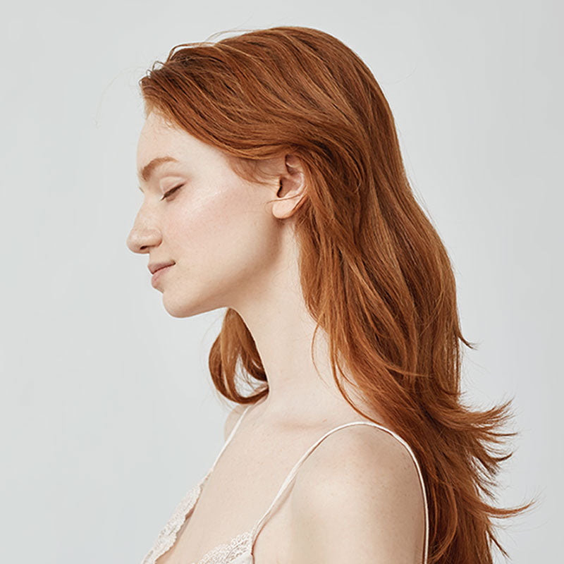 Profile of woman with red hair
