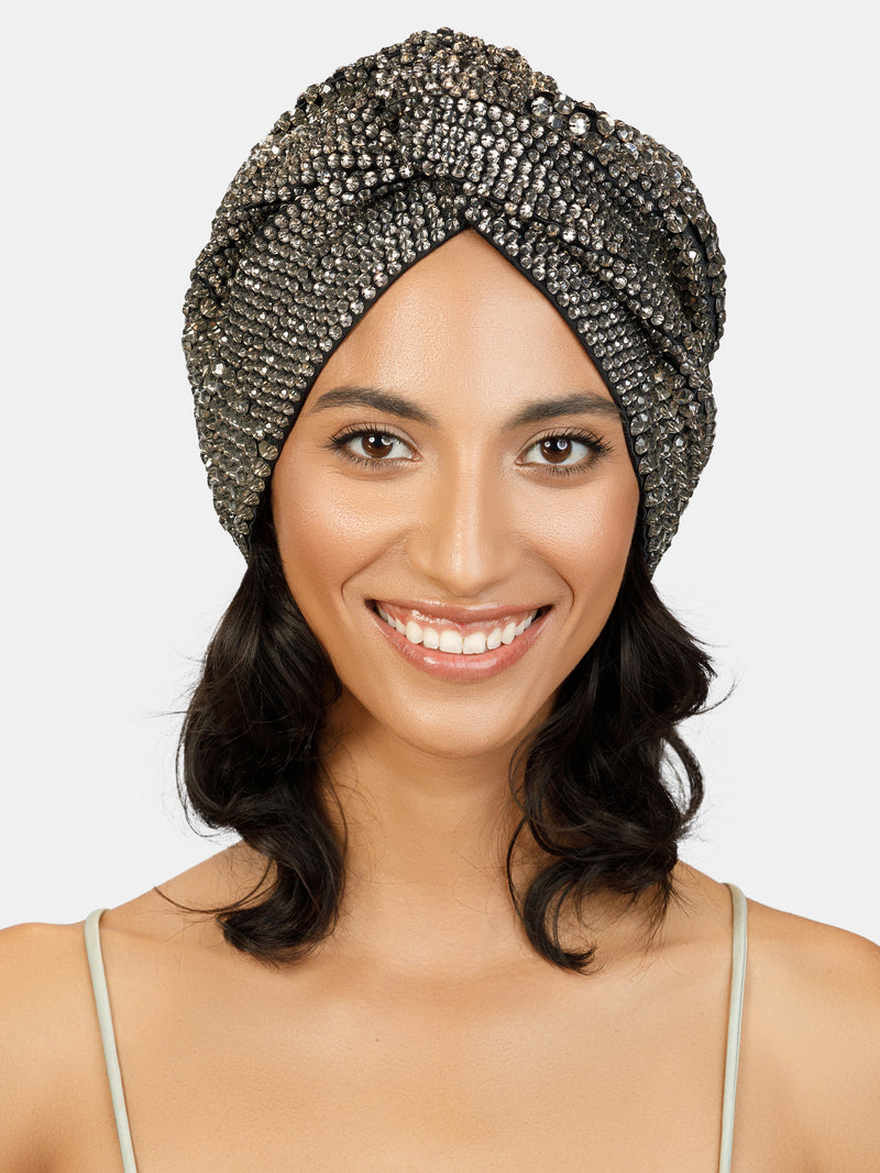 Crystal embroidered turban. Glass faceted sequins in taupe colors hand embroidered on black cotton and stretch fabric. Designed by Maryjane Claverol.