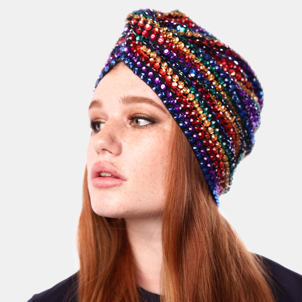 Crystal embroidered turban. Faceted acrylic bead in rainbow colors embroidered on black stretch fabric. Designed by Maryjane Claverol.