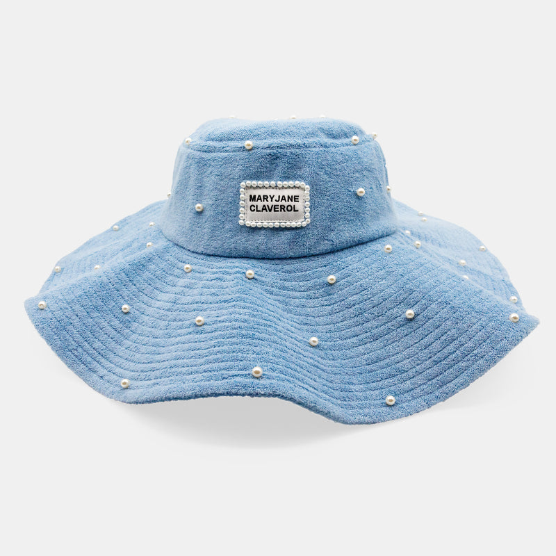 Wide brim, pearl embellished terry cloth bucket hat designed by Maryjane Claverol.  Edit alt text
