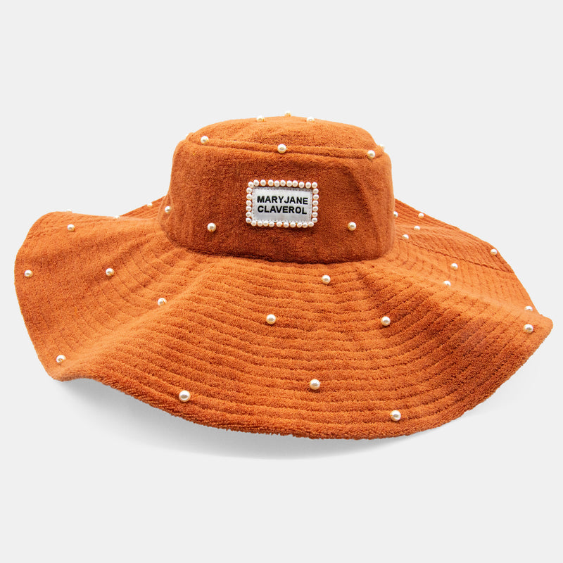 Wide brim, pearl embellished terry cloth bucket hat designed by Maryjane Claverol.