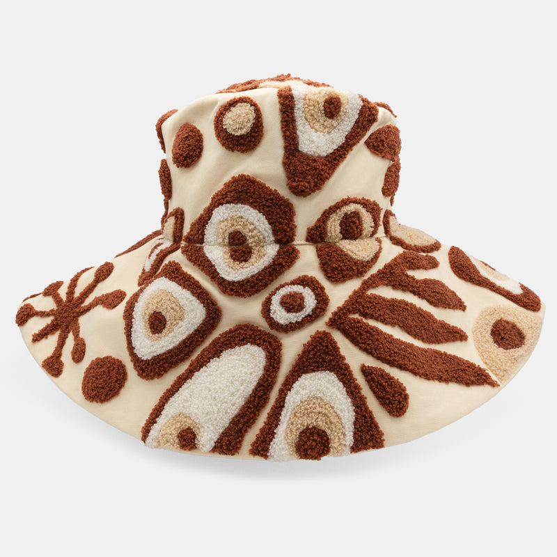Abstract motif embroidered bucket hat. Wide floppy brim.