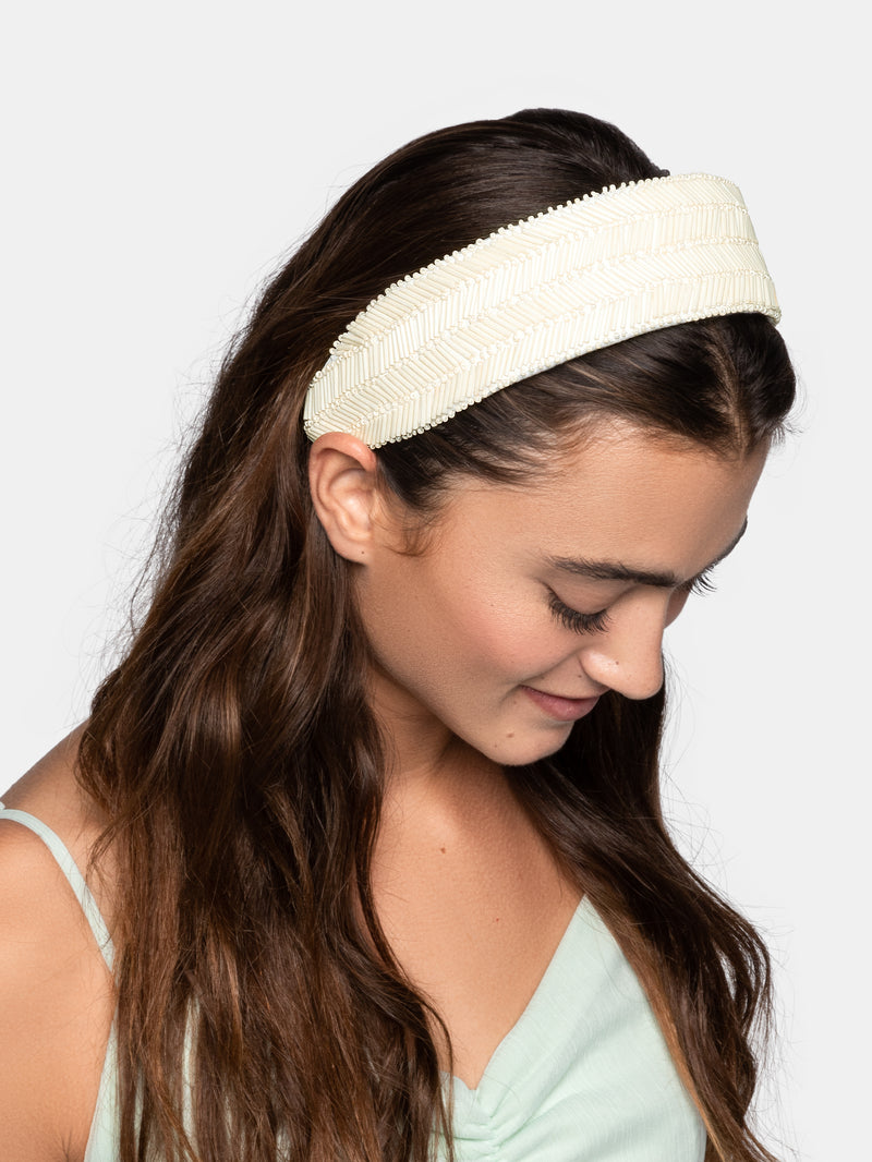 Wide flat base headband with multiple beads designed by Maryjane Claverol.