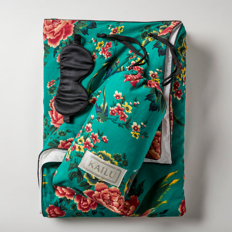 Open Road Portable Throw Set comes with a throw in two tone (vintage 1950s Shanghai peony and bird print on vibrant emerald linen fabric on one side and white on the other side) with black piping, carrying pouch, and mulberry silk eye mask