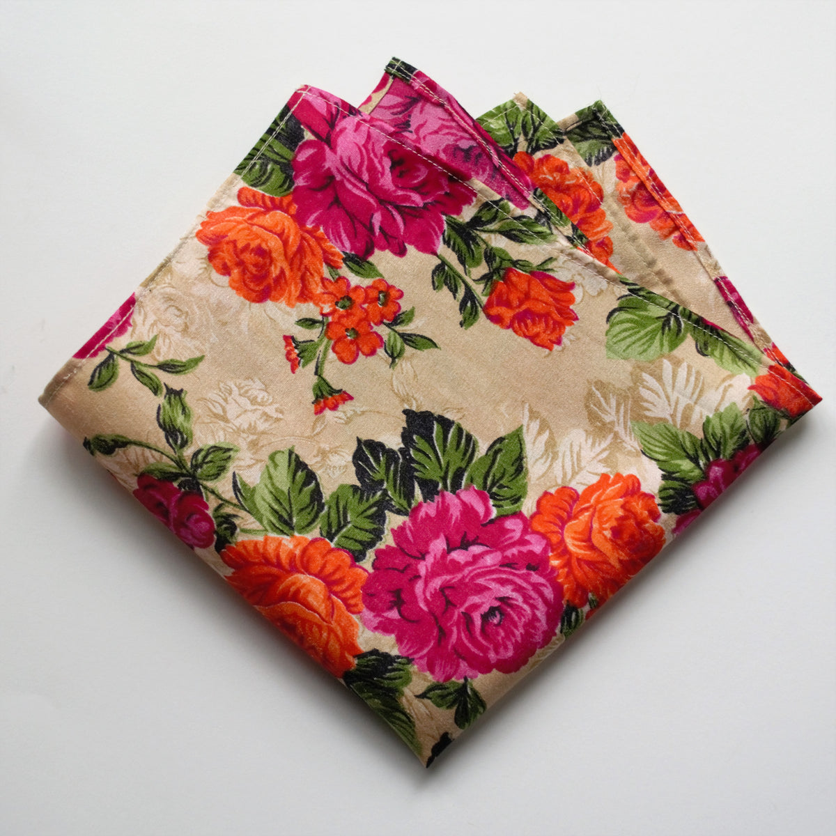Photo of a bright floral pocket square made by Brook Pooni Non Profit.