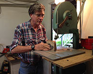 John Tudehope using bandsaw
