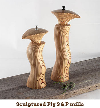 photo of sculptured salt and pepper mills