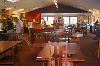 Customers checking out Wooden Tables and Chairs