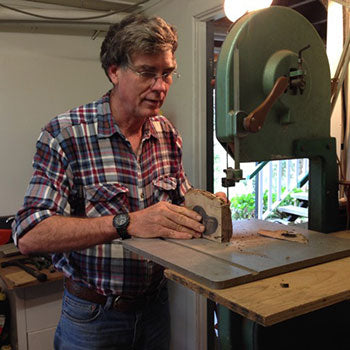 Australian woodworker using a machine