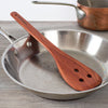 Picture of a Red Hardwood Egg Flip stop a lidded frying pan