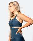 Side on view of active mum wearing aspen nursing bra
