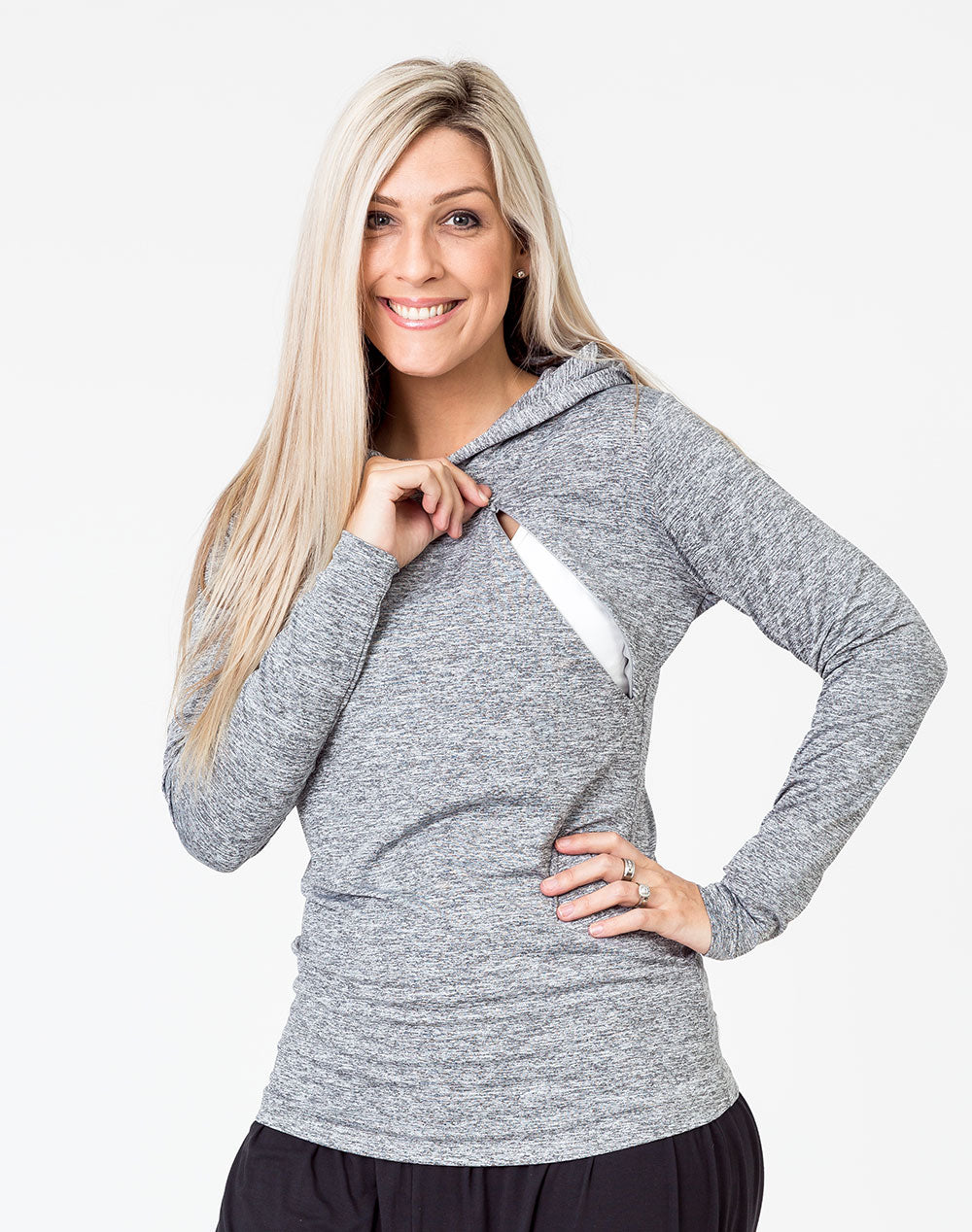 front view of a mum unzipping one invisible zip on a grey breastfeeding hoodie to breastfeed
