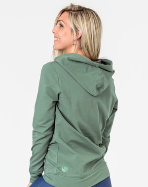 back view of a pregnant woman wearing a khaki breastfeeding hoodie