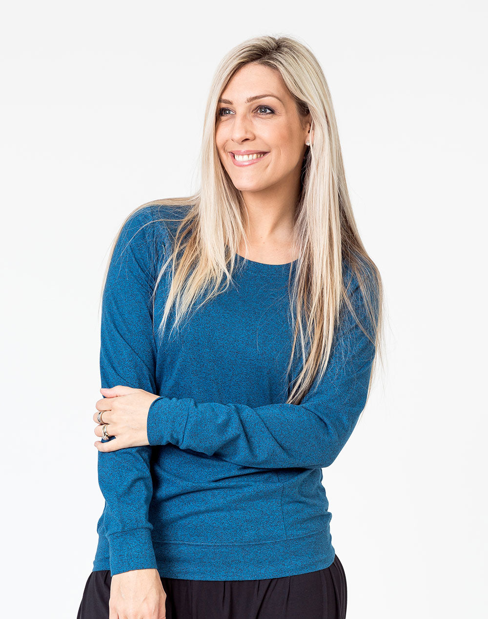 active mum wearing a navy maternity top with long sleeves and invisible zips for breastfeeding