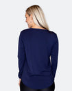 back view of a mum wearing a blue top with a scooped hem