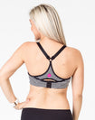 back view of a black and white striped maternity activewear bra with a racerback and Cadenshae logo