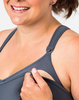 close up of a woman wearing a plus size nursing bra with one drop down cup for nursing unclipped