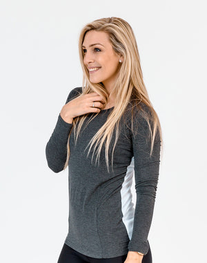 yoga mum wearing a grey maternity top with long sleeves