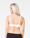pregnant mum wearing a white playtime bra back view showing the option to wear as a normal bra