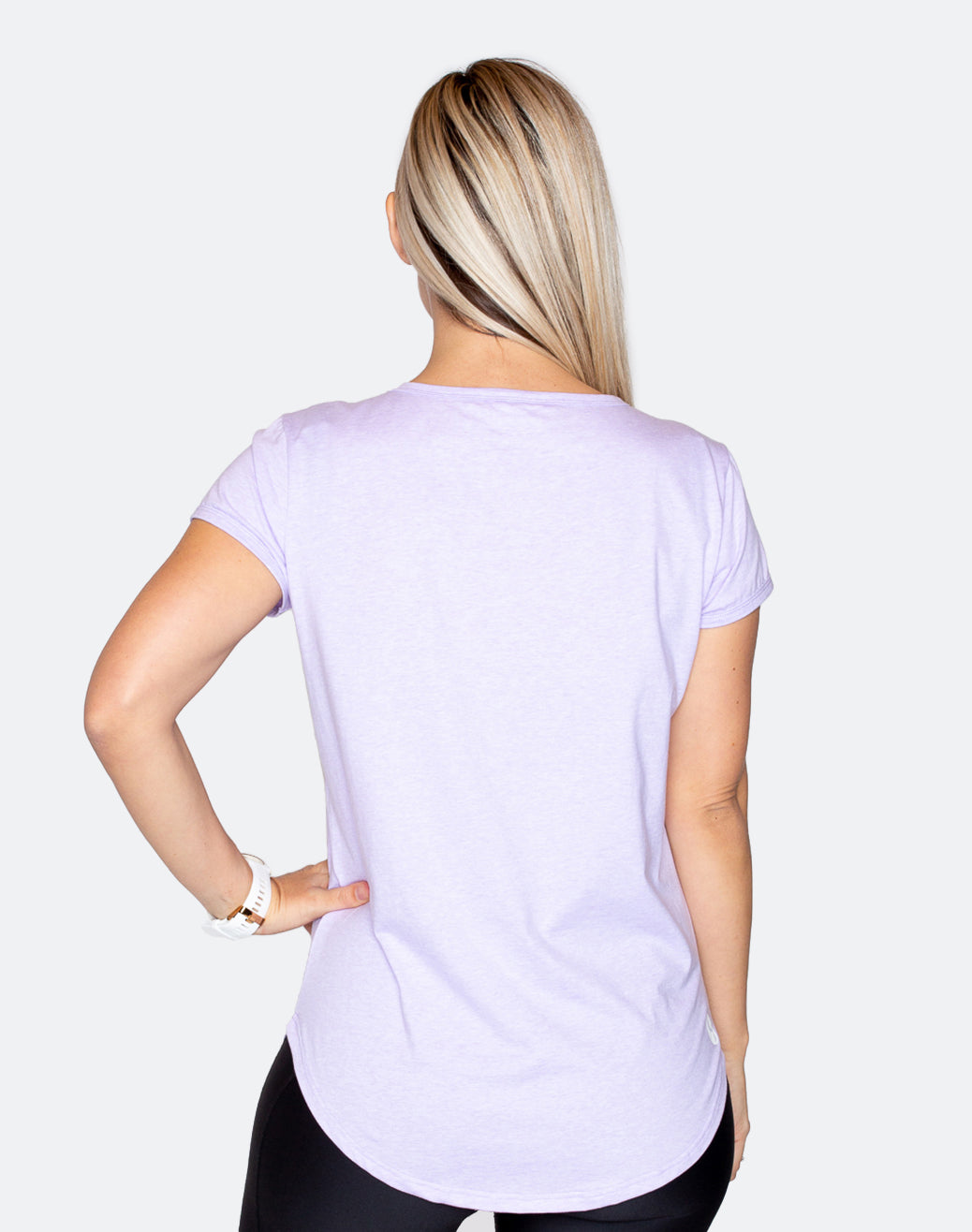 side view of an active mum in a lilac breastfeeding workout t-shirt