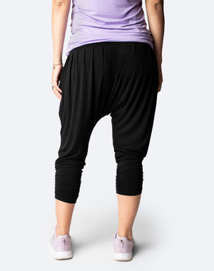 side view of a mum wearing black maternity harem pants