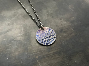Hints of Intrepid round necklace