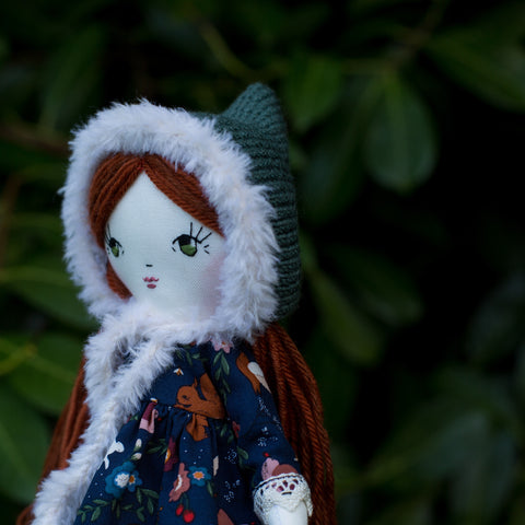 handmade cloth doll in forest dress and pixie hat