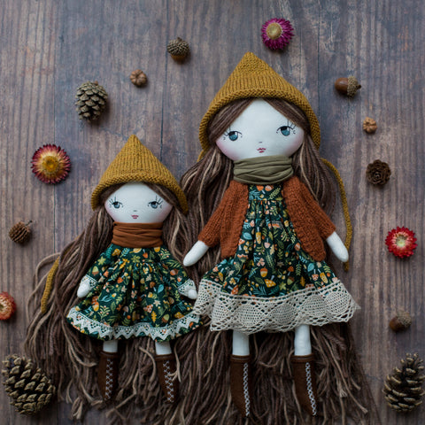 handmade cloth doll wearing forest dress and pixie hat