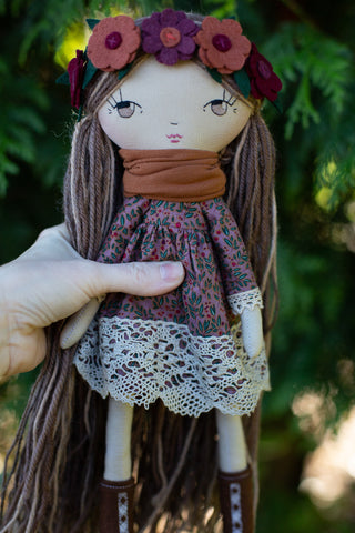 handmade cloth doll with floral lace dress in autumn colours and flower headband